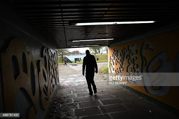 A man walks through an underpass near Rotherham town centre South Yorkshire North England on October 6 2014 An inquiry revealed on August 26 2014...