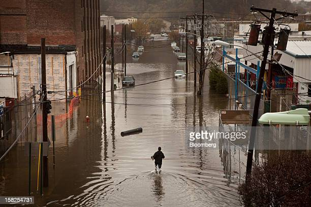 BEST PHOTOS OF 2012 A man walks through flood waters in Hoboken New Jersey US on Tuesday Oct 30 2012 The Atlantic storm Sandy left a landscape of...