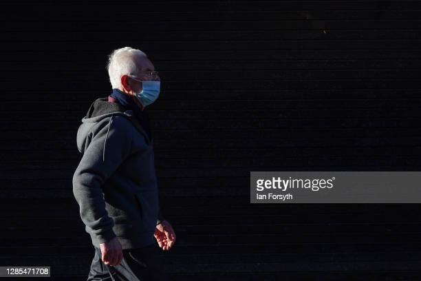 Man walks through Hull city centre on November 13, 2020 in Hull, England. Hull recorded 726.8 new cases per 100,000 people in the week to November 7,...