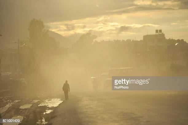 A man walks through mass of dust and air pollution at Patan Nepal on Saturday July 22 2017 Kathmandu has been ranked as the third most polluted city...