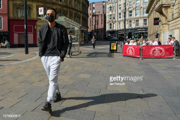 A man walks through Newcastle city centre on September 17 2020 in Newcastle upon Tyne England Almost two million people in northeast England will be...