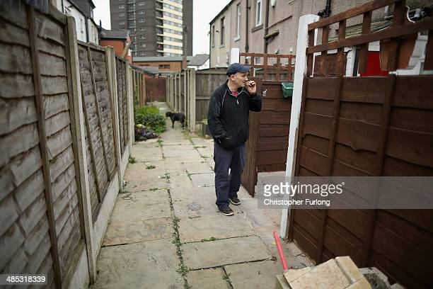 A man walks through Rudman Yard in Rochdale some of the first social houses built by the Rochdale Pioneers the founders of the modern cooperative...