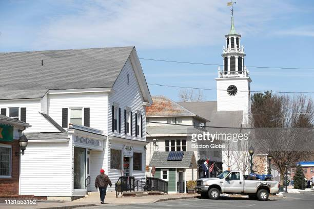 A man walks through Sheffield MA on March 14 2019 The small Berkshire County town of Sheffield is mourning the tragic deaths of a young family and a...