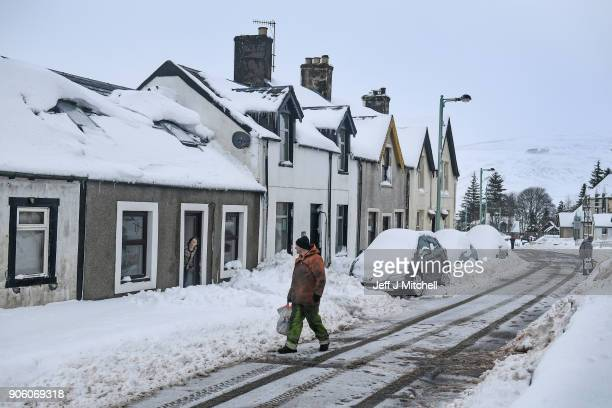 A man walks through snow on January 17 2018 in Leadhills Scotland Motorist have been requested to avoid unnecessary journey on major routes as...