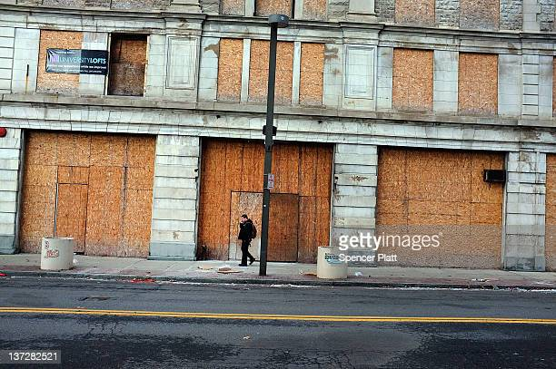 A man walks through struggling downtown Binghamton on January 18 2012 in Binghamton New York Binghamton in the Southern Tier of New York State is at...