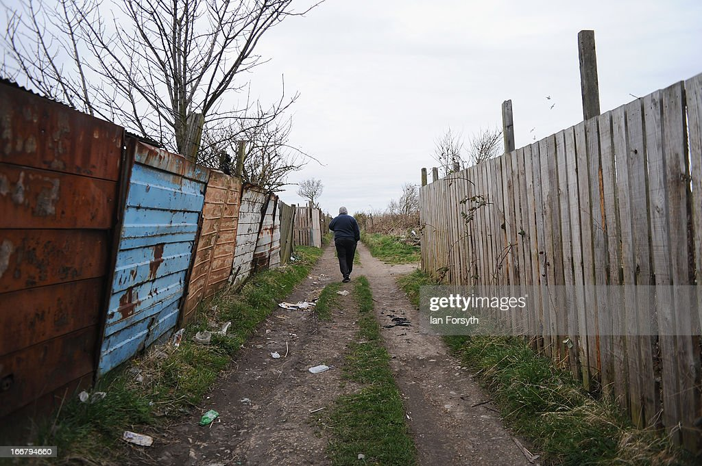 A man walks through the allotments on April 17, 2013 in Easington, England. Former miners and their families are today holding a commemoration party for the closure of the pit at Easington Colliery; coinciding with the ceremonial funeral for Baroness Thatcher, who took on the mining union during the miners' strike which ultimately led to the closure of the mines and the loss of jobs. Dignitaries from around the world today join Queen Elizabeth II and Prince Philip, Duke of Edinburgh as the United Kingdom pays tribute to former Prime Minster Baroness Thatcher during a Ceremonial funeral with military honours at St Paul's Cathedral. Lady Thatcher, who died last week, was the first British female Prime Minister and served from 1979 to 1990.