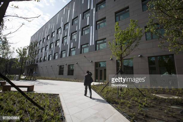 A man walks through the American Institute in Taiwan's new complex in Taipei Taiwan on Tuesday June 12 2018 The American Institute in Taiwan's new...
