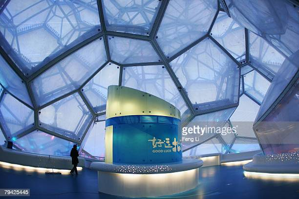 """Man walks through the audience's rest area which is named """"Bubbles Bar"""" before the """"Good Luck Beijing"""" World Swimming China Open at the National..."""