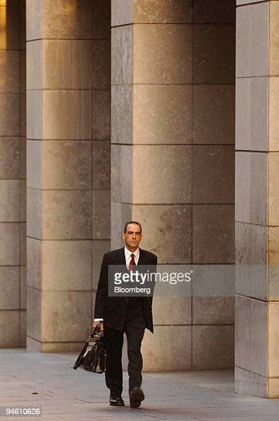A man walks through the city in Sydney Australia on Monday Feb 19 2007 Australian wages growth probably accelerated in the fourth quarter as a...