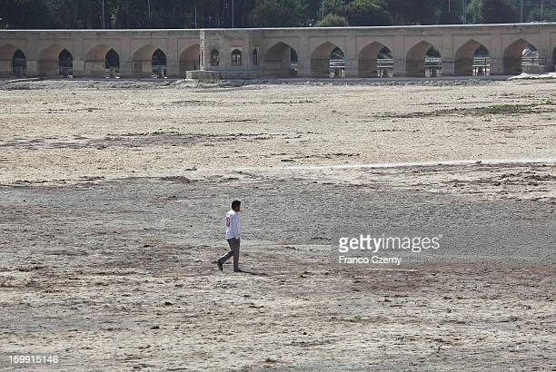A man walks through the dry bank of the Zayandeh river on August 07 2012 in Isfahan Iran
