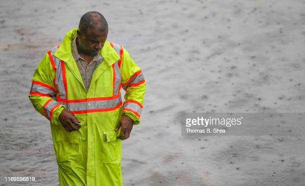 A man walks through the flood waters off of highway 69 North on September 19 2019 in Houston Texas Gov Greg Abbott has declared much of Southeast...