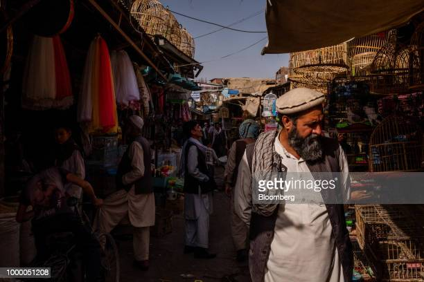 A man walks through the Kah Froshi bird market in Kabul Afghanistan on Thursday July 12 2018 US President Donald last year said 16000 US troops would...