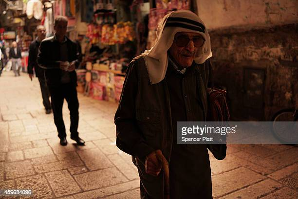 A man walks through the Muslim quarter in the Old City on November 28 2014 in Jerusalem Israel Nine Israelis have been killed in a series of...