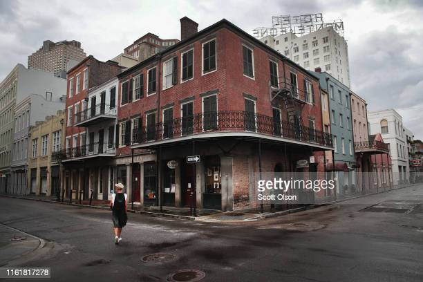 Man walks through the nearly-empty streets of the French Quarter as the city braces for Barry on July 13, 2019 in New Orleans, Louisiana. Many...