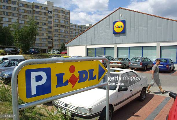 A man walks through the parking lot of a Lidl supermarket July 18 2003 in Ceske Budejovice Czech Republic Lidl Germany's secondlargest discount...