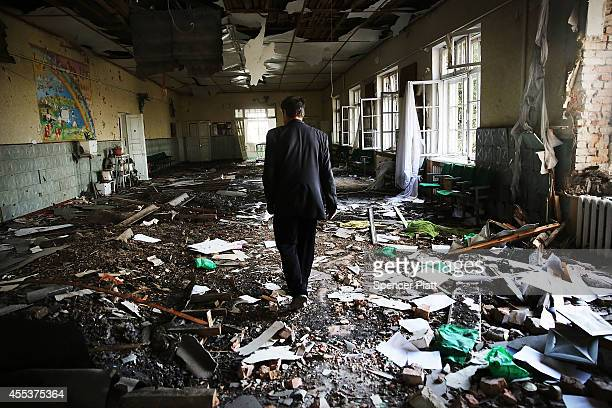 A man walks through the remains of an elementary school that has been turned into an bomb shelter in the war battered city of Lugansk on September 13...