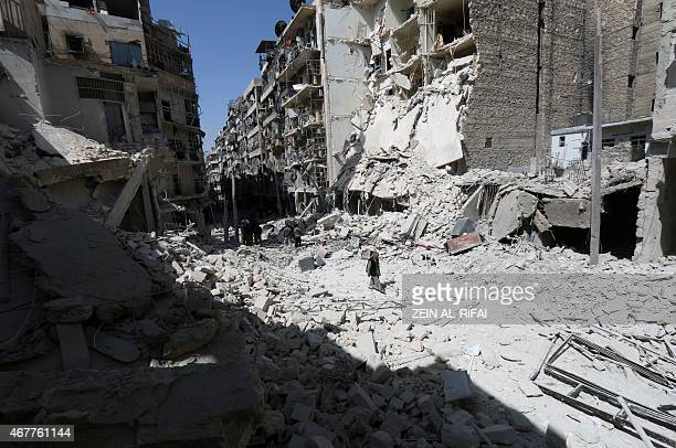 A man walks through the rubble following reported air strikes by government forces on the eastern Shaar neighbourhood of the northern Syrian city of...