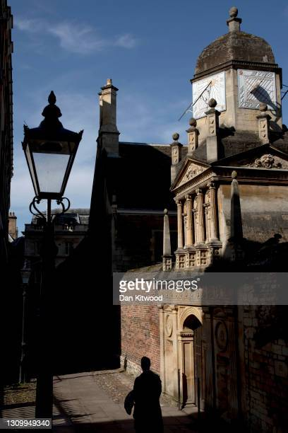 Man walks through the shadows on March 30, 2021 in Cambridge, England. Forecasters are predicting temperatures of 22C and with the easing of pandemic...