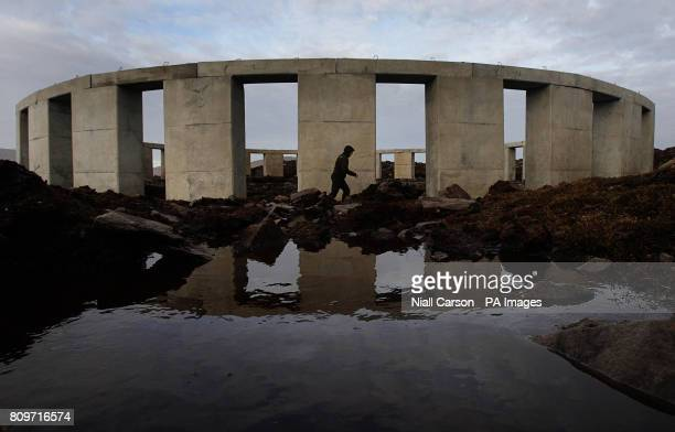 A man walks through the site dubbed AchillHenge on Achill Island Co Mayo where people gathered this morning to watch the Winter Solstice