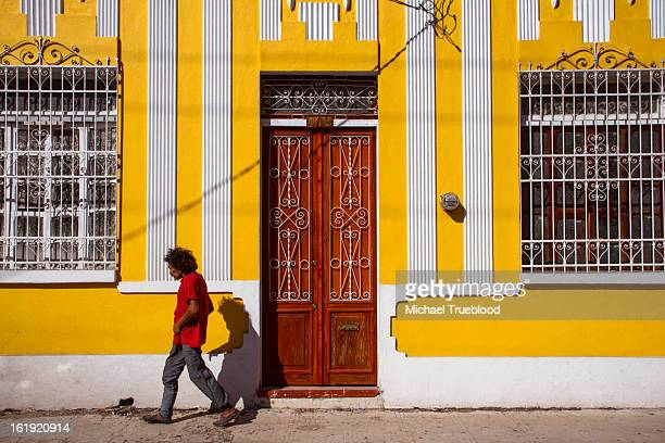 CONTENT] Man walks through the streets of the old town of Merida Mexico