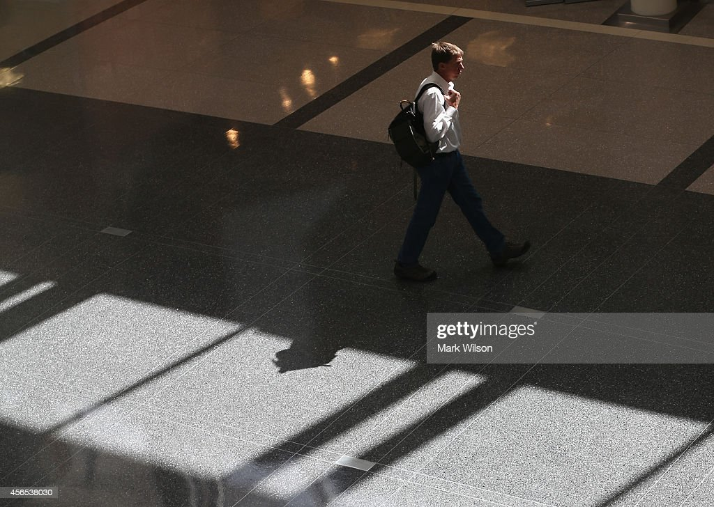 A man walks through the terminal at Washington Dulles International Airport October 2, 2014 in Dulles, Virginia. The Center for Disease Control CDC announced that Ebola patient being treated at the Texas Presbyterian hospital passed through Washington Dulles airport on a United Airlines flight two weeks ago.