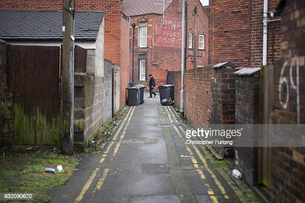 A man walks through the traditional back alleys of Stoke on January 19 2017 in StokeonTrent England The StokeOnTrent central byelection has been...