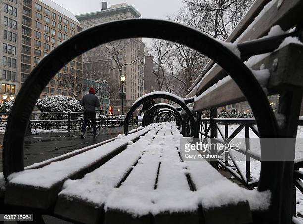 Man walks through Union Square park in the snow on January 14, 2017 in New York City.