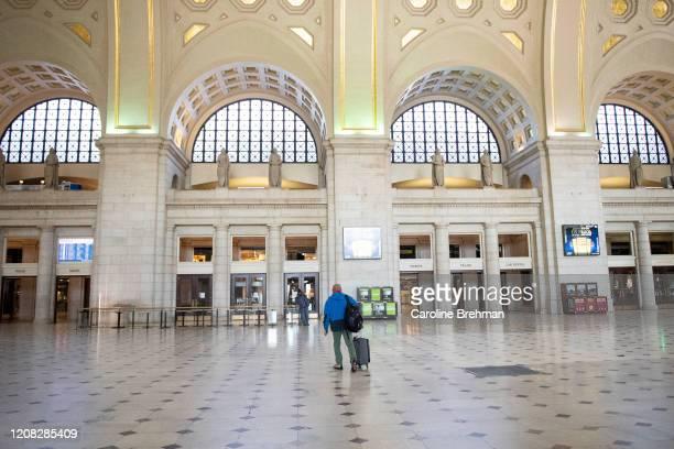 Man walks through Union Station on Thursday, March 26, 2020.