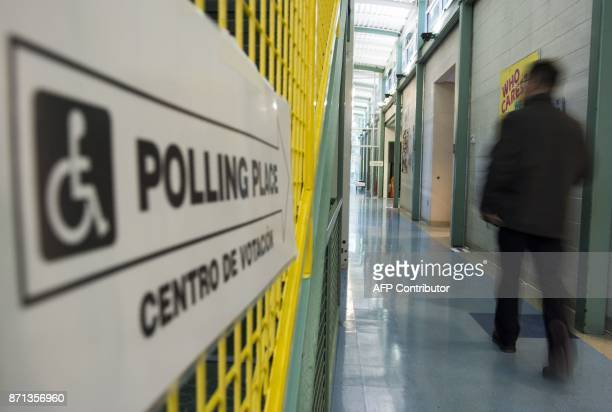 A man walks to a polling station to cast his vote in Arlington Virginia on November 7 2017 In New Jersey and Virginia voters will elect a new...