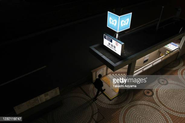 A man walks to a subway station entrance on May 29 2020 in Tokyo Japan On May 25 Japanese government lifted the declaration on the remaining last...