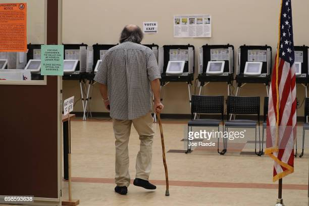 A man walks to the voting station to cast a ballot during a special election in Georgia's 6th Congressional District special election at North Fulton...