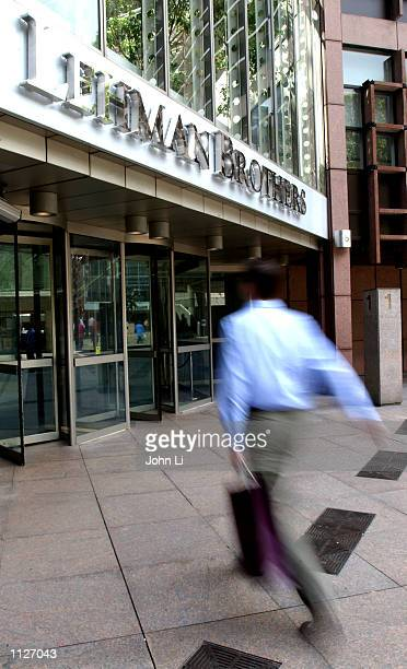 A man walks toward the Lehman Brothers offices July 15 2002 in London United Kingdom Profits at the big banking and brokerage firms have steadily...