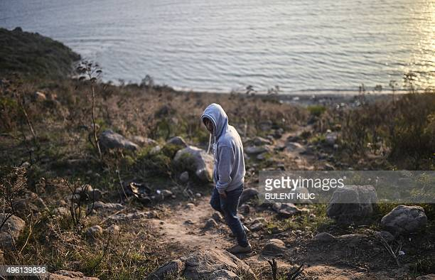 A man walks towards a beach as migrants and refugees wait for the night to fall to try to cross to the Greek island of Kos from Bodrum in the Turkish...