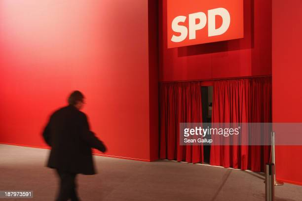 Man walks towards a curtain to where leading party members were arriving at the federal party convention of the German Social Democrats on November...
