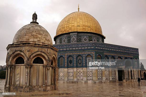 A man walks towards the Dome of the Rock at the AlAqsa mosque compound in the Old City on November 27 2014 in Jerusalem Israel The Dome of the Rock...