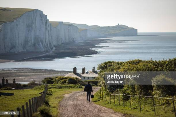 A man walks towards the Seven Sisters cliffs from Seaford Head on May 15 2018 in Seaford England Situated within the South Downs National Park Seven...