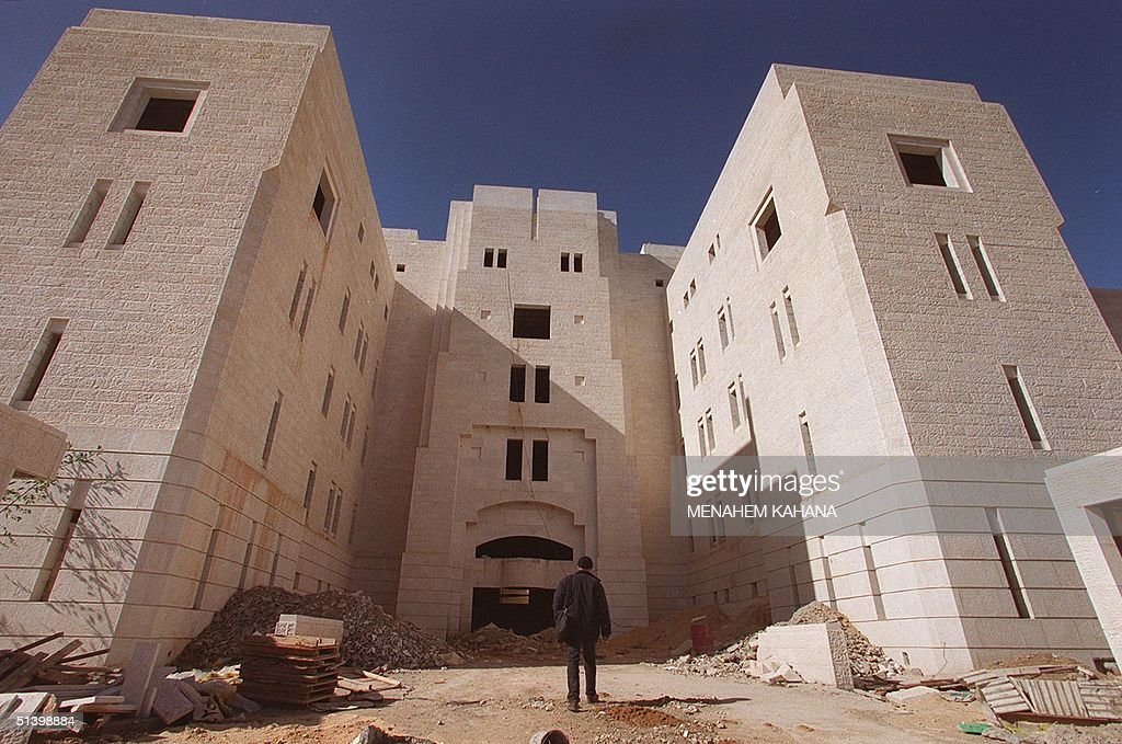A man walks towards what is slated to be the Palestinian parliament... News Photo - Getty Images