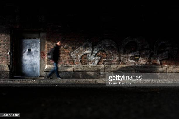 A man walks under a bridge on January 09 2018 in Berlin Germany