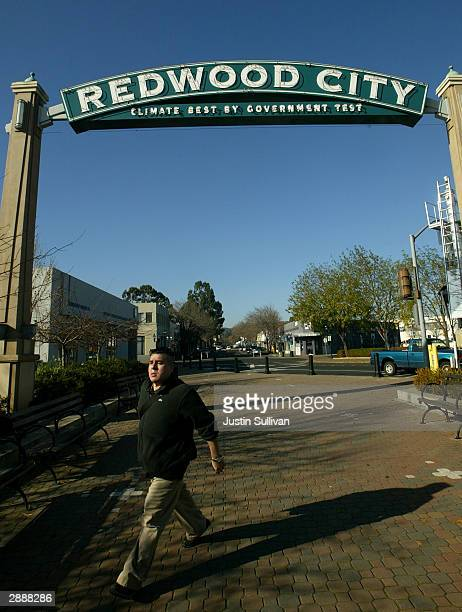 Man walks under a sign January 21, 2004 in downtown Redwood City, California. A judge Tuesday ordered the high-profile trial of Scott Peterson, who...