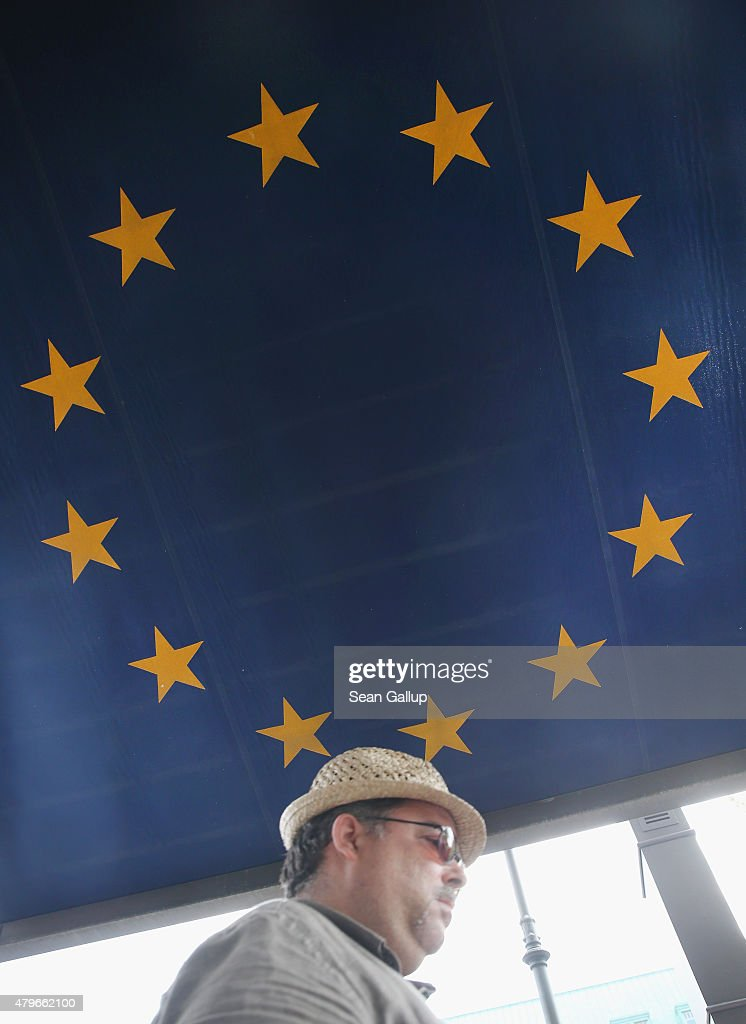 A man walks under an awning decorated as the flag of the European Union the day after a majority of people voted 'no' in the Greek referendum on July 6, 2015 in Berlin, Germany. Greeks voted in a strong majority against the reform plan proposed by the troika of the European Central Bank, the International Monetary Fund and the European Commission in a move that many fear will lead to a departure by Greece from the Eurozone.