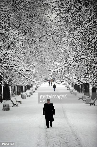 A man walks under the snow in Sofia on December 18 during the first snow fall of the season AFP PHOTO / DIMITAR DILKOFF
