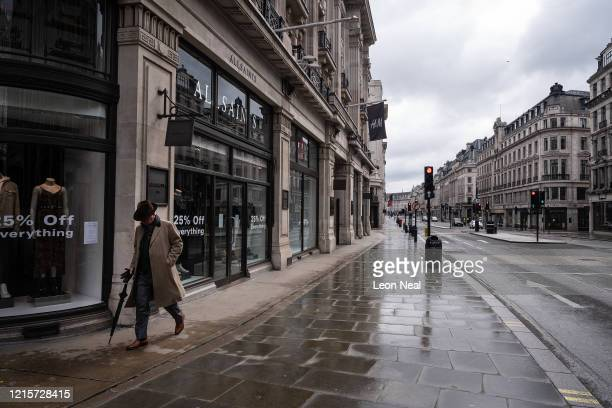 Man walks up a deserted Regent Street on March 30, 2020 in London, England. The Coronavirus pandemic has spread to many countries across the world,...