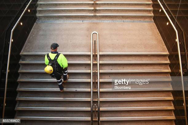 A man walks up a flight of stairs at Martin Place in Sydney Australia on Thursday Aug 17 2017 Australian employers added more jobs than forecast in...