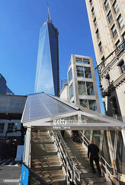 A man walks up a stairway as One World Trade Center now the tallest building in the United States continues to be constructed on May 16 2013 in New...