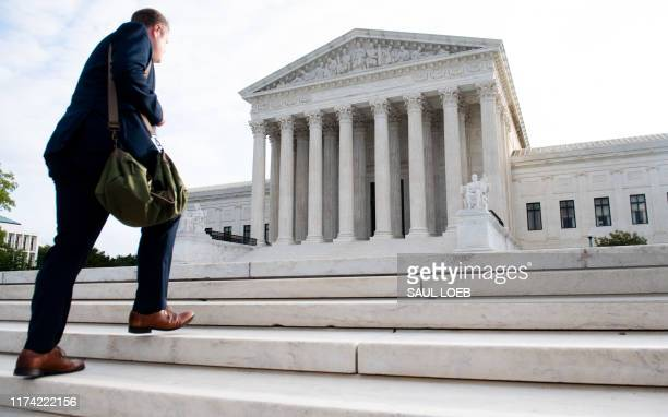 """Man walks up the steps on the first day of a new term at the US Supreme Court in Washington, DC, October 7, 2019. - In the film """"12 Angry Men,"""" a..."""