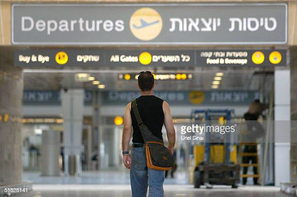 Man walks up to the departures hall in the new terminal under construction at the Ben Gurion International Airport October 21, 2004 in Israel. The...
