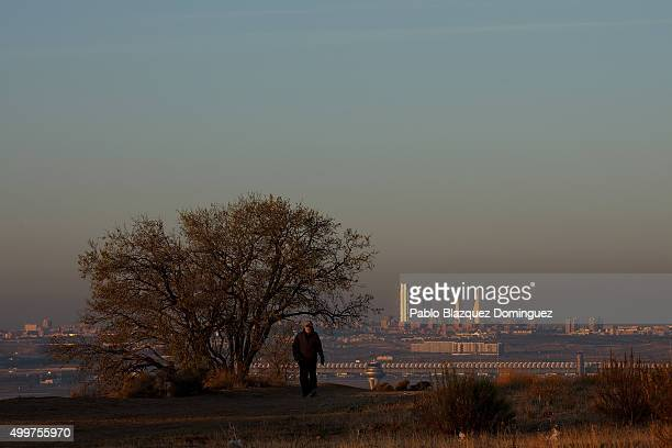 A man walks while the city skyline of Madrid is seen behind on December 3 2015 in Madrid Spain For the second time in a month Madrid City Council has...