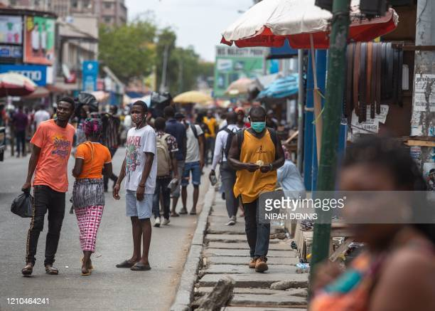 Man walks with a face mask at the Kantamanto market after the partial lockdown in parts of Ghana to halt the spread of the COVID-19 coronavirus was...
