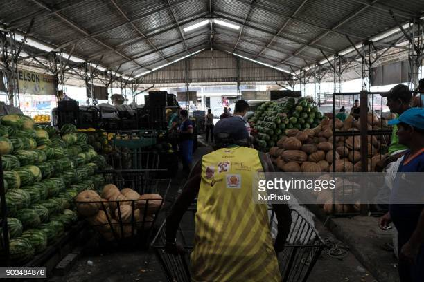 A man walks with a shopping cart at a popular market in the city of Recife Northeast Brazil on January 10 2018 A study by the Department of...