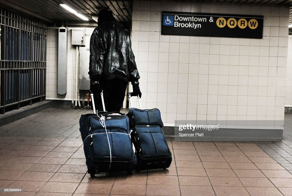 A man walks with his bags at a Manhattan train station on December 14, 2017 in New York City. According to a new report released by the U.S. Department of Housing and Urban Development New York City's homeless population expanded by about 4 percent in 2017 as the number of homeless people nationwide grew to about 553,000.